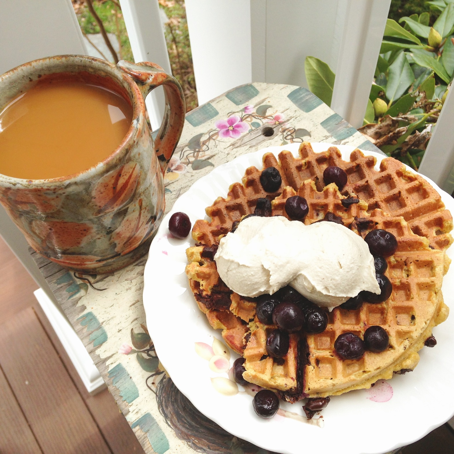 Homemade waffles with cashew cream and coffee