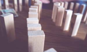 Jenga pieces fall like dominos